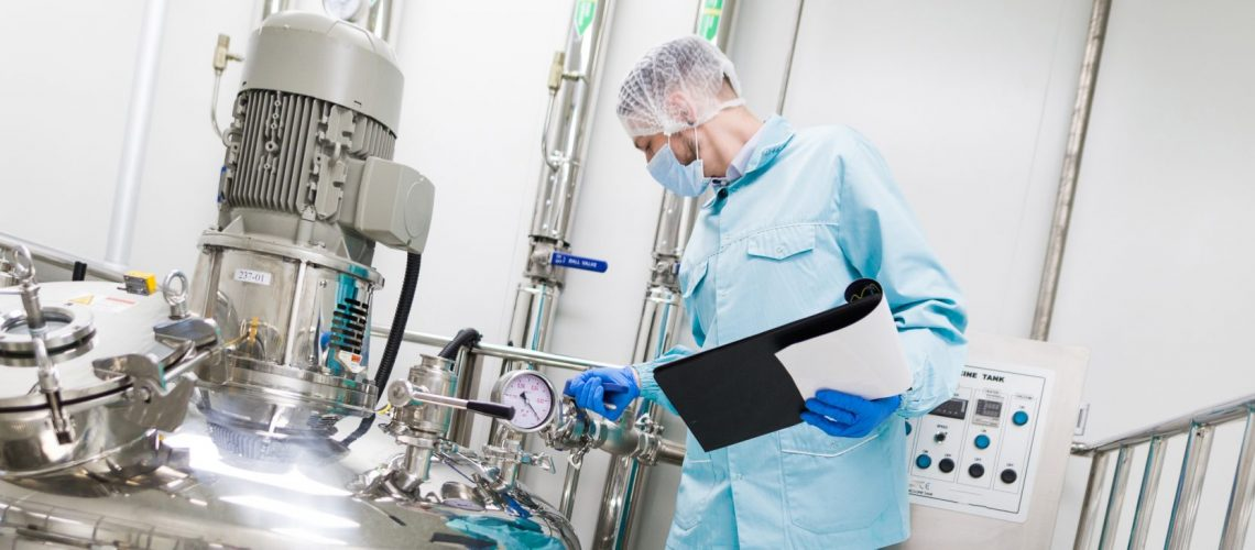 Wide-screen,Picture,,Scientist,In,Blue,Lab,Suit,And,Gas,Mask